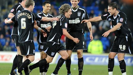 Jimmy Bullard is mobbed by team-mates after scoring a second wonder goal at Cardiff in March 2011. P