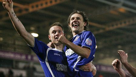 Jimmy Bullard congratulates Connor Wickham on completing his hat-trick in a 6-0 win at Doncaster in