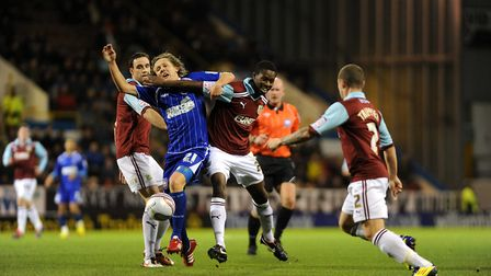 Jimmy Bullard is blocked off during a 4-0 loss at Burnley - a team display Paul Jewell labelled as '