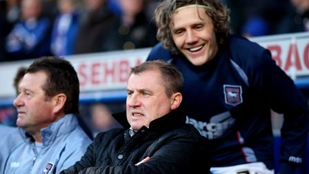 Ipswich Town manager Paul Jewell looks on from the touchline as player Jimmy Bullard jokes behind hi