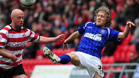 Jimmy Bullard stretches for the ball against Doncaster. Photo: Archant