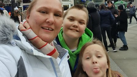 Mum Rebecca Bland with her two children Alex and Samantha on a day trip out to London. Picture: REBE