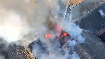 Drone footage shows the blaze at the Lion pub in Leavenheath. Picture: SUFFOLK FIRE AND RESCUE