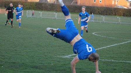 Head over heels! Michael Brothers celebrates a goal for Brantham. Photo: Ella Bailey Photography