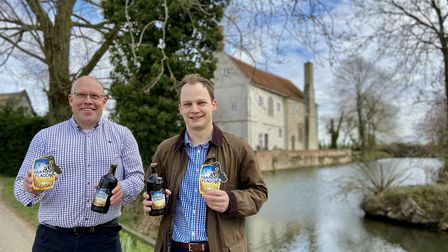 John Hadingham, managing director of St Peter's Brewery, and competition winner Will Sargent with bo