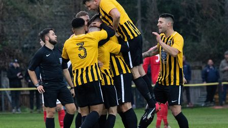 Happier times this season: Stowmarket Town celebrate during their 2-1 win over Mildenhall. Picture: