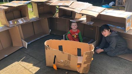 """Tracey Poll said she has """"failed on many levels"""". Her kids built a fort out of boxes, which her 4-ye"""