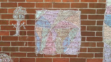 Danielle McCarthy's art lesson for her son on the side of her house! Picture: DANIELLE MCCARTHY
