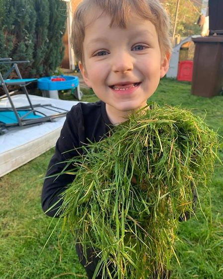 Sabrina Clarke said her son Harrison, 5, hasn't done much school work, but he helped mow the grass