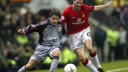 Roy Keane, showing his battling qualities as a player against Bayern Munich's Owen Hargreaves during