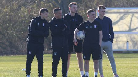 Chris Smith (centre) watches an Under-23s game along with fellow Ipswich Town academy graduates Ben