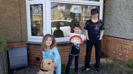 Left to right: Tayla, six, Zak, eight, and Derron, 17, who are all learning at home in Ipswich due t