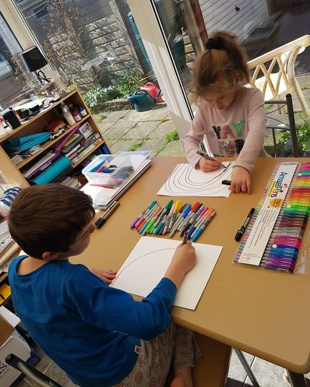 Tayla, six, and Zak, eight, making rainbows Picture: TRACY NOBLE