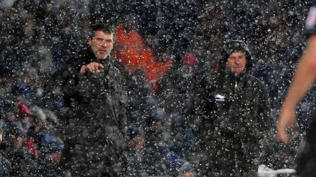 Football action from a snow covered Portman Road in December 2010 as Roy Keane watches on. Picture: