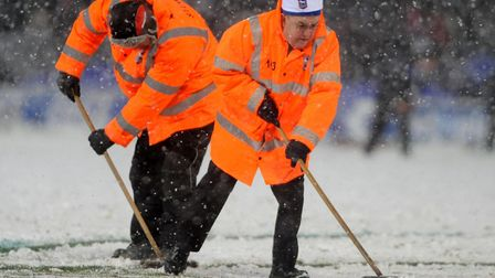Town groundstaff clear the lines during the game against Leicester back in 2010. Picture: ARCHANT