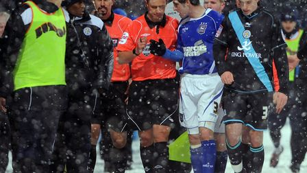 Referee Stuart Atwell being begged to keep the game on