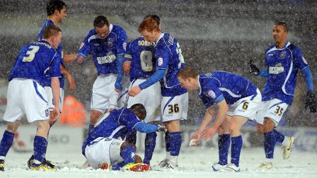 Town players celebrate the third goal of the game as they Town beat Leicester City 3-0 at a snow cov