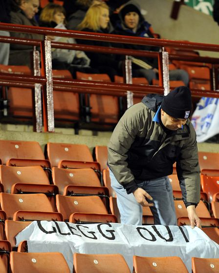 One Town fan places a 'Clegg Out' baanner on the seats at Oakwell in 2011