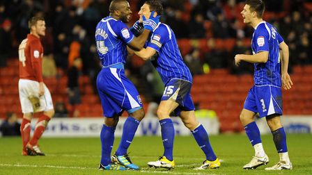 Jason Scotland celebrates with Keith Andrews as Town won 5-3 at Barnsley in December 2011