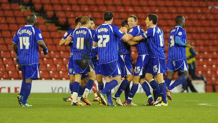Town players celebrate one of their five goals in the 5-3 at Barnsley in December 2011