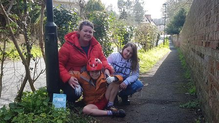 Joanna Rowles with her children Ollie, seven, and Daisy, ten, while out on their daily walk. Picture