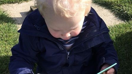 Benjamin Cowie, 2, found his first book out with his mother Cat. Picture: CAT COWIE