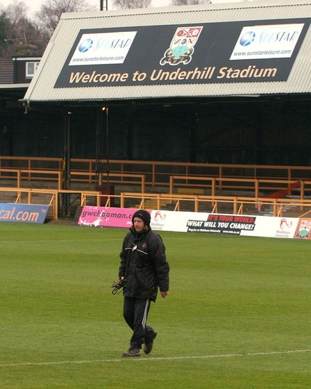 Barnet's former Underhill ground, their home from 1907 to 2013, with a groundsman walking across a s