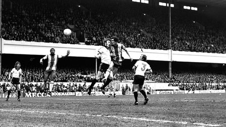 Kevin Beattie competes for a header as Mick Mills watches on against West Brom in the FA Cup semi-fi