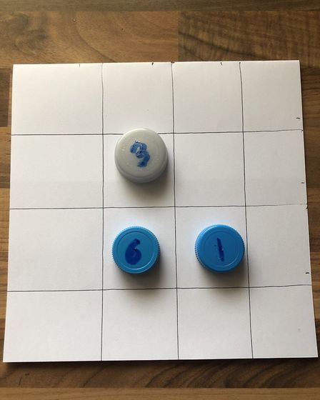 You can easily make your own board and counters at home