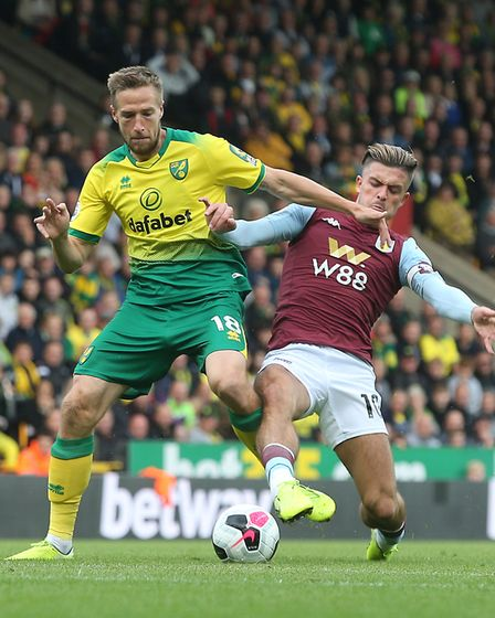 Marco Stiepermann of Norwich and Jack Grealish of Aston Villa in action during the Premier League ma
