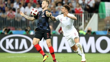 Croatia's Ivan Rakitic and England's Kyle Walker battle for the ball during the FIFA World Cup. Walk