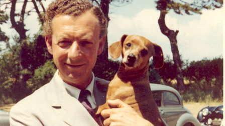 Benjamin Britten holding his dog Clytie in The Red House garden, Aldeburgh, late 1950s His home movi