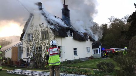 Firefighters at the scene of a large thatched farmhouse blaze Picture: SUFFOLK FIRE AND RESCUE SERV