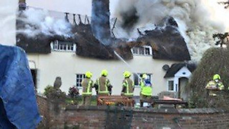 Firefighters at the scene of a large thatched farmhouse blaze Picture: SUFFOLK FIRE AND RESCUE