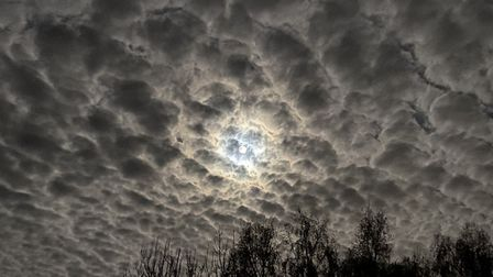 A muffled supermoon breaks through the clouds Picture: BRAD JONES