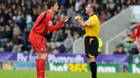 Owen Garvan pleads with referee Pat Miller in a game at Plymouth in 2008. Photo: Pagepix