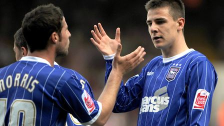 David Norris celebrating with Owen Garvan during a game against Doncaster in 2009. Photo: Archant