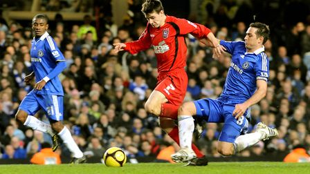 Owen Garvan drives beyond Frank Lampard in an FA Cup tie against Chelsea in 2009. Photo: Archant