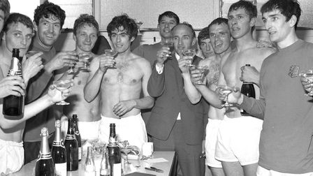 The bubbly is flowing as Town celebrate winning the Second Division championship in 1968. From left,