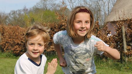 Suffolk siblings Kate and Tom have completed a marathon in their back garden to raise money for East
