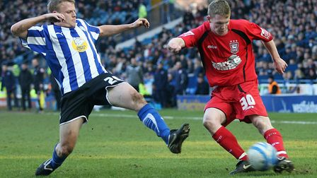 Shane O'Connor, right, on his Ipswich Town league debut, takes on Sheffield Wednesday's Frank Simek.