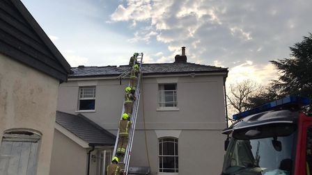 Firefighters have been tackling a blaze that started in the roof of Hawstead Hall in west Suffolk P