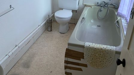 Another bathroom in the property, before community groups did their utmost to get it ready to house