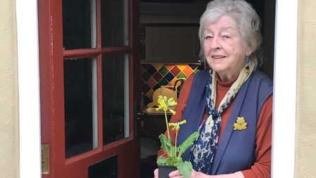 Wendy, one of the recipients, with a plant donated by Woottens of Wenhaston and delivered by Haleswo