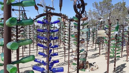 Elmer's Bottle Farm outside Barstow, California, is an iconic Route 66 tourist attraction - a forest