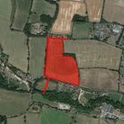 Two schemes for homes on a plot of land in Onehouse have been put before councillors within the same