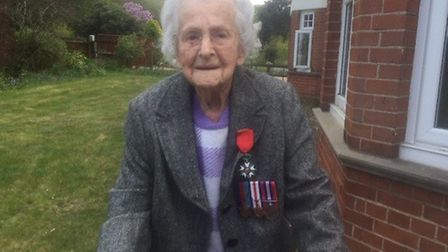 Marjorie West, 99, has completed her 100th lap and is going to continue walking to raise money for t