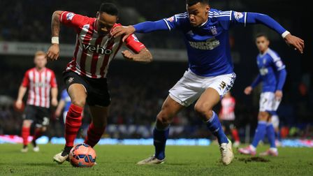 Tyrone Mings, right, made his name at Ipswich Town