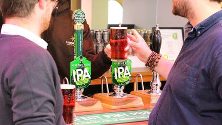 Drinkers enjoying a Greene King IPA at a bar pre-lockdown Picture: BECKY HAYWOOD