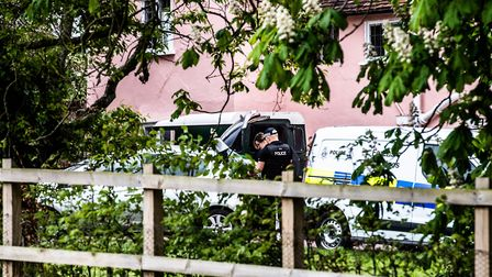 Uniformed police officers and forensics attend the scene of a shooting at a house in Barham Picture: